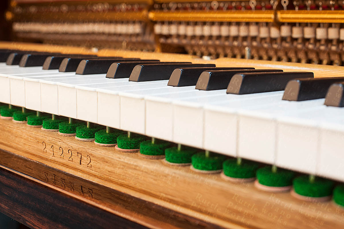 Photo of piano keys after leveling by Ruttle piano works