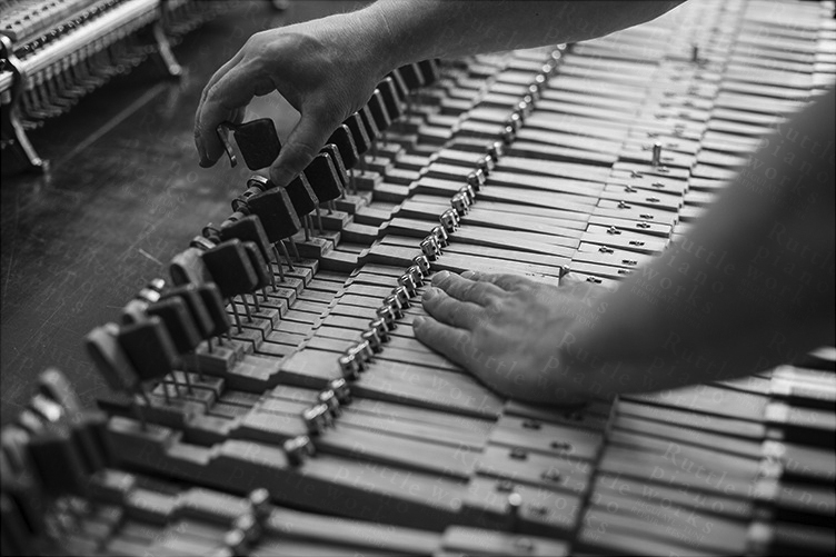 Photo depicting key leveling at Ruttle piano works